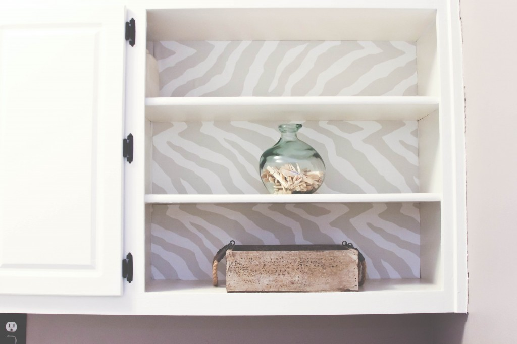Wall paper lined cabinet
