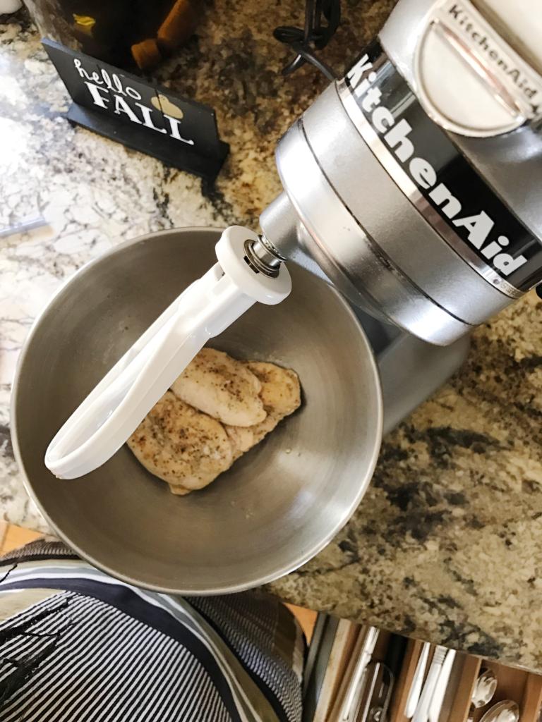 Shred chicken breast in a mixer to make this chicken veggie crescent braid recipe.